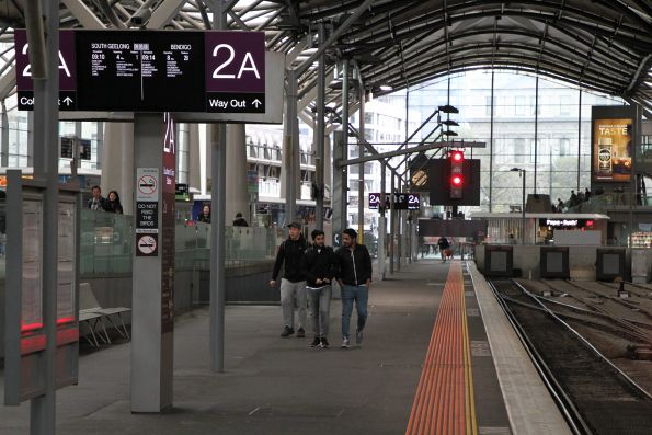 Black panel forms a view block behind signal SST520 at Southern Cross Station