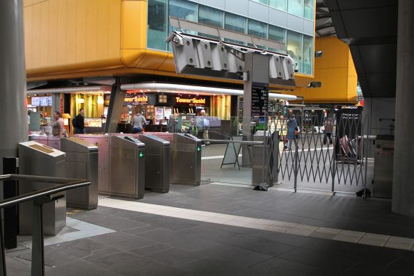 Metal gates in use as an overflow exit at Southern Cross platform 1