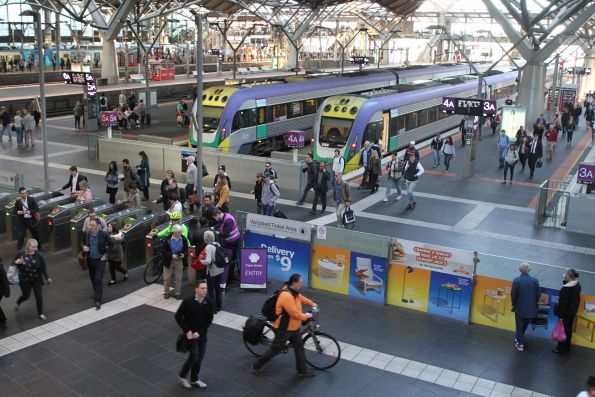 V/Line passengers depart their train at Southern Cross