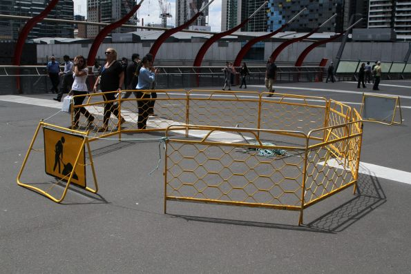 Fenced off work site on the Bourke Street Bridge at Southern Cross Station