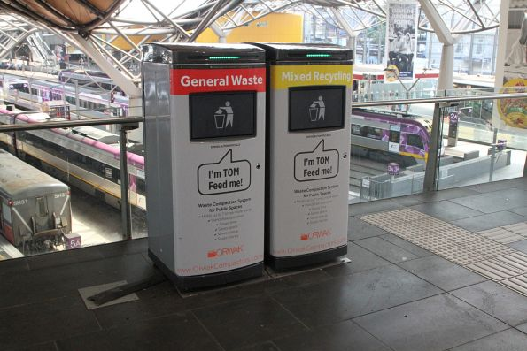 Rubbish and recycling compacting bins on the Collins Street concourse at Southern Cross Station
