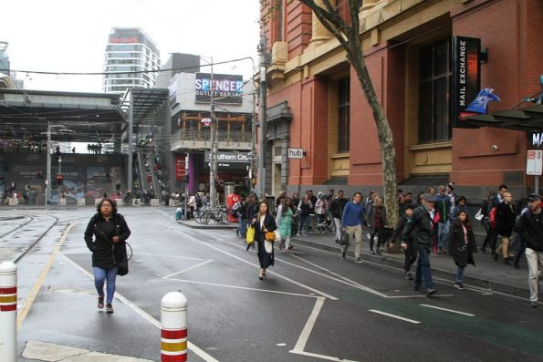 Pedestrians headed every which way between Southern Cross Station and the Bourke Street tram stop