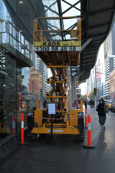 Scissor lift between jobs on Spencer Street