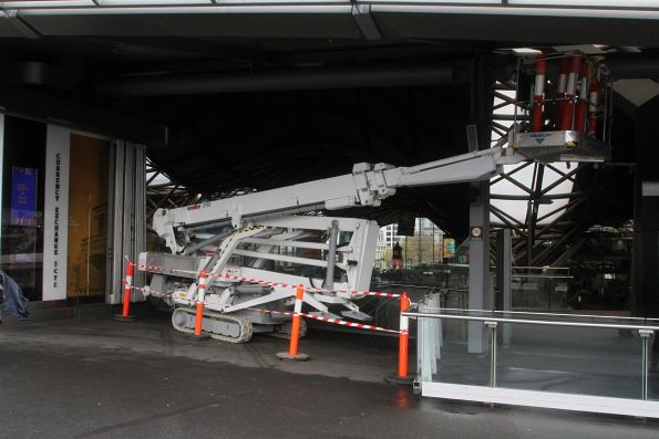 Boom lift parked between jobs on the Bourke Street bridge