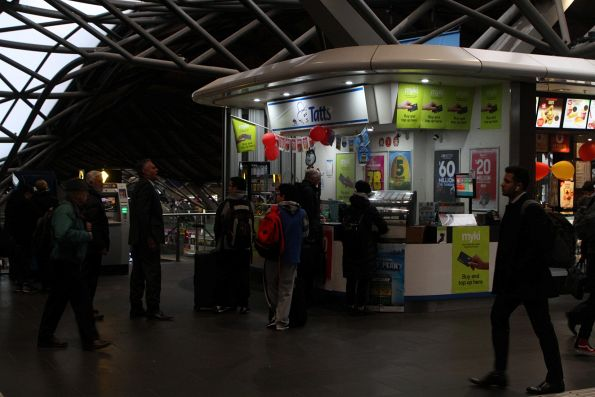 Tatts outlet on the Collins Street concourse covered with Myki posters