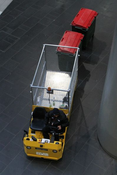 Electric buggy tows a pair of rubbish bins