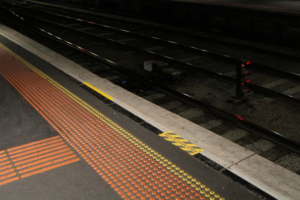 Additional 'Watch your step' signage where Southern Cross platform 7 is cut away beside a crossover