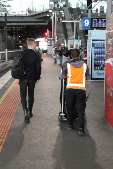 Cleaning staff pick up rubbish at Southern Cross Station