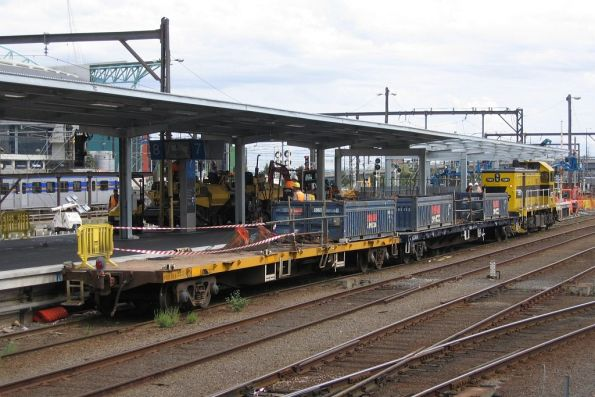 T381 on platform 7 with a short works train, made up of two flat wagons loaded with open top containers