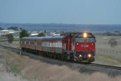 N473 on a down Warrnambool Cup special with club car 'Victoria' and power van PCO2 in the consist, at Grovedale
