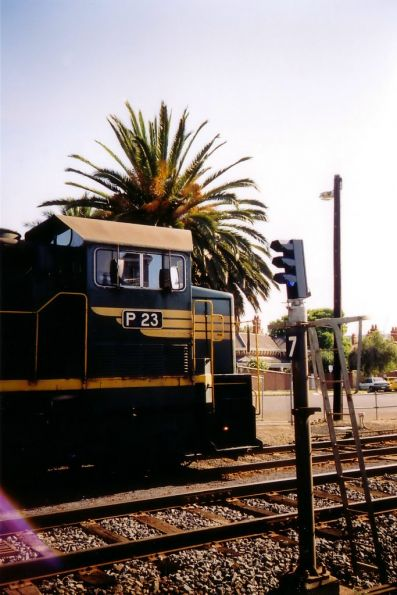 Freight Australia liveried P23 leads a push-pull H set at South Geelong