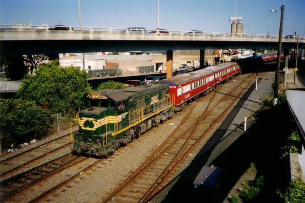 Freight Australia liveried P23 leads a push-pull H set out of Geelong