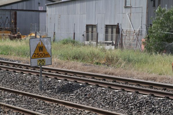 Speed restriction sign on the Victorian standard gauge - 'warning' of a 20 km/h restriction in 2500 metres