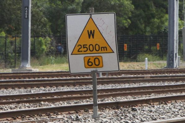Speed restriction sign on the Victorian standard gauge - 'warning' of a 60 km/h restriction in 2500 metres