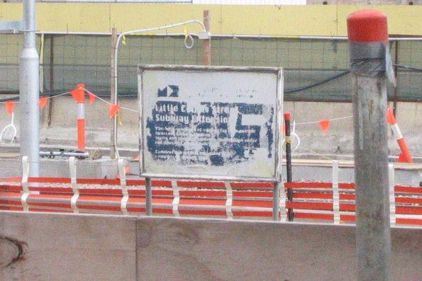 Faded Melbourne Docklands authority branded 'Little Collins Street Subway Extension' sign opposite platform 14