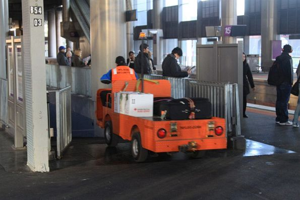Wilson Security staff drives an electric buggy loaded with parcels and baggage into the subway from platform 14