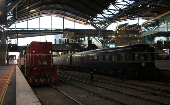 Y156 beside the train at Southern Cross