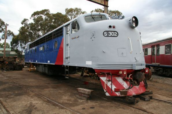 S302 propped up minus bogies beside the turntable at Seymour