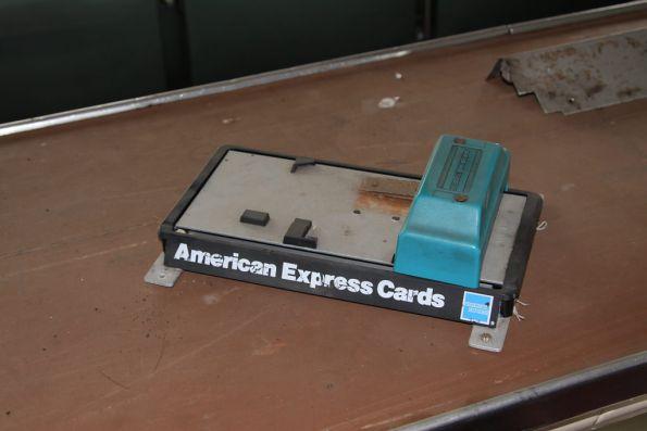Old-school Amex card swiper in buffet car Tanjil