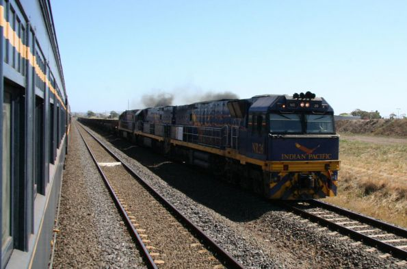 Melbourne bound Indian Pacific liveried NR26 and NR25 lead PN liveried NR45 through Corio