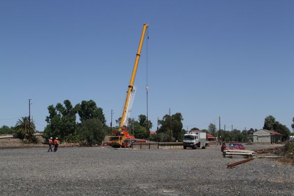 Road crane in place to place the new BGGX/BGGY grain hoppers onto the rails at Benalla