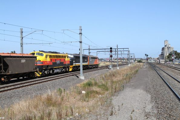 S302 leads S312 and B75 on an up Deniliquin grain onto the goods line at Sunshine
