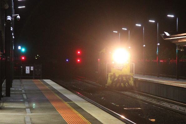 T385 heads light engine through Sunshine, headed from South Dynon to Bendigo