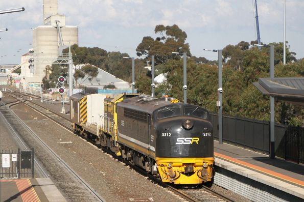 S312 and T363 lead X'Trapolis transfer transition wagon BQHX 2447 and power van BVDY52 through Sunshine bound for Bendigo