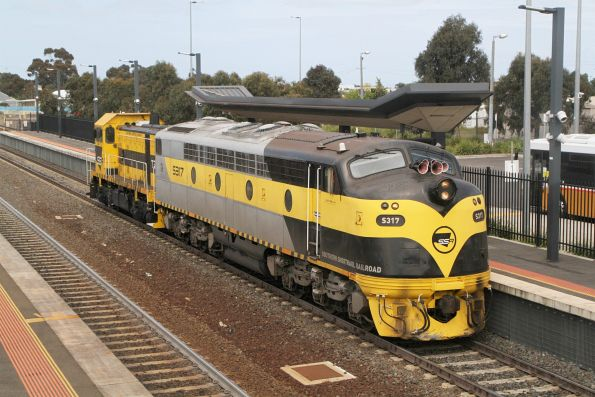 S317 leads T386 through Sunshine on a down light engine move to Bendigo