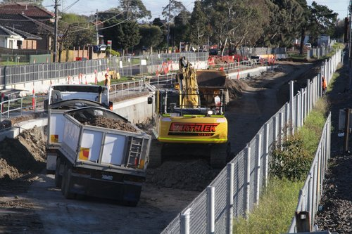 Removing dirt from the rail cutting at the down end of the new Ginifer station