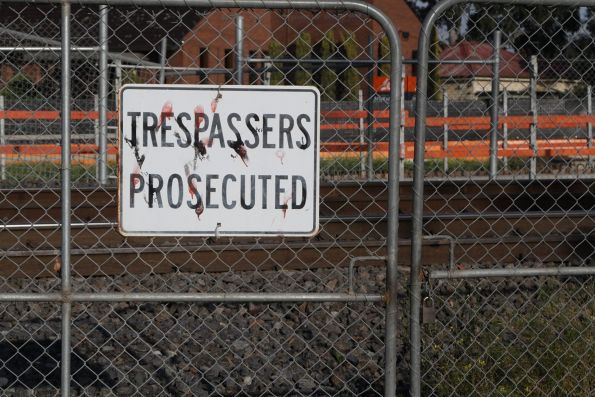 'Trespassers prosecuted' sign on a gate at St Albans station