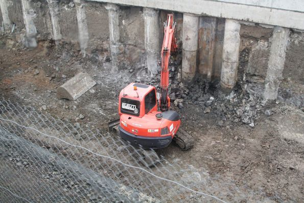 Excavator removing rock in the cutting at the up end of St Albans station