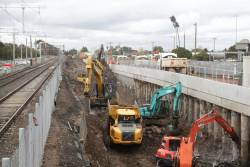 Excavators removing rock from the rail cutting at the up end of St Albans station