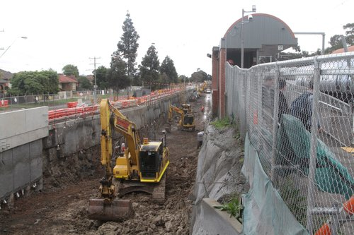 Rail cutting well underway behind the existing station at Ginifer