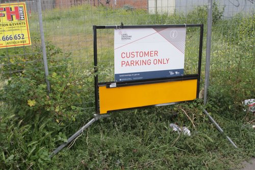 LXRA branded 'Customer Parking Only' sign at the shopping strip on Willaton Street