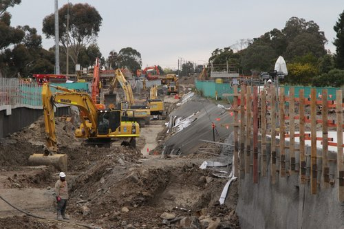 Looking north to excavators moving rock from the rail cutting north of St Albans station