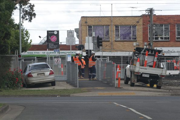 Safeworking staff monitor the new gates at the Willis Street pedestrian crossing