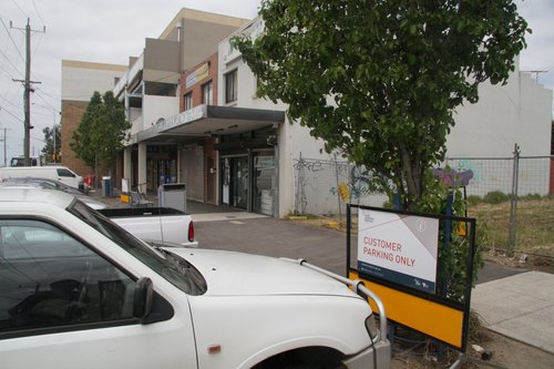 'Customer parking only' sign at the shopping strip opposite Ginifer station