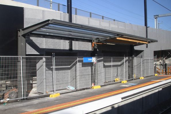Temporary shelter for wheelchair users added to the steel frame at Ginifer platform 2