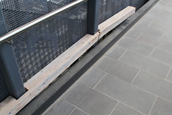 Bits of timber block the gap between ramp and parapet at St Albans station