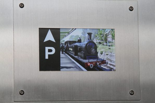 Steam locomotive features in the loop of pictures displayed inside the lift at St Albans station