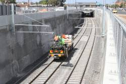 Hi-rail crew at work north of St Albans station to get the overhead ready for the return of train services