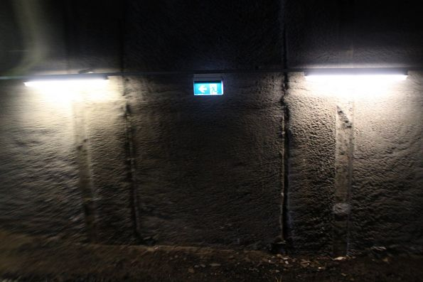 Emergency lighting and exit signage beneath Furlong Road at Ginifer