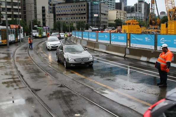Diverting motorists onto the tram tracks to avoid floodwaters on St Kilda Road