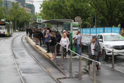 Crowd of waiting southbound passengers at St Kilda Road and Park Street