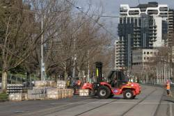 Forklift moving paving stones and kerbing for the St Kilda Road platform stop works