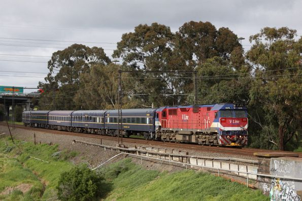 N475 leads the empty cars run on the up at Yarraville
