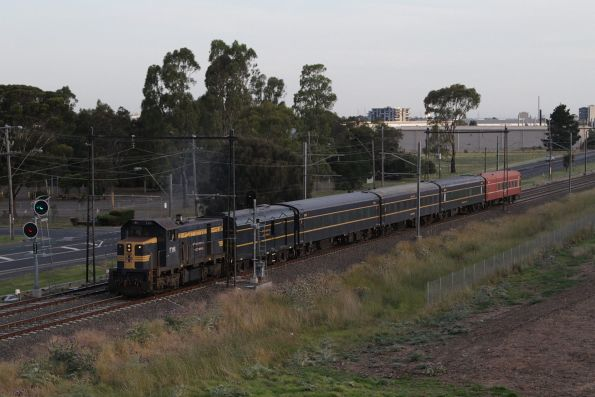 T395 leads a five car consist north out of Albion
