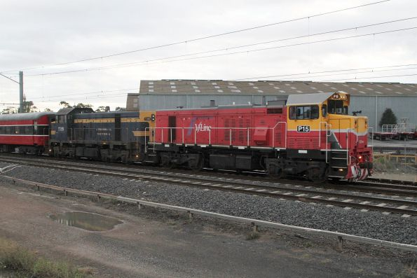 P15 leads T395 on a down Steamrail Christmas charter through Albion bound for Kyneton