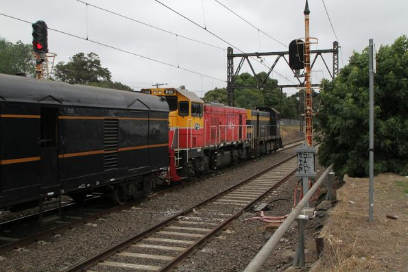 T395 leads P15 on the up empty cars move from Newport Workshops bound for Southern Cross
